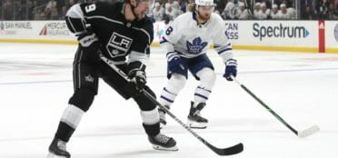 Adrian Kempe #9 of the Los Angeles Kings skates against William Nylander #88 of the Toronto Maple Leafs