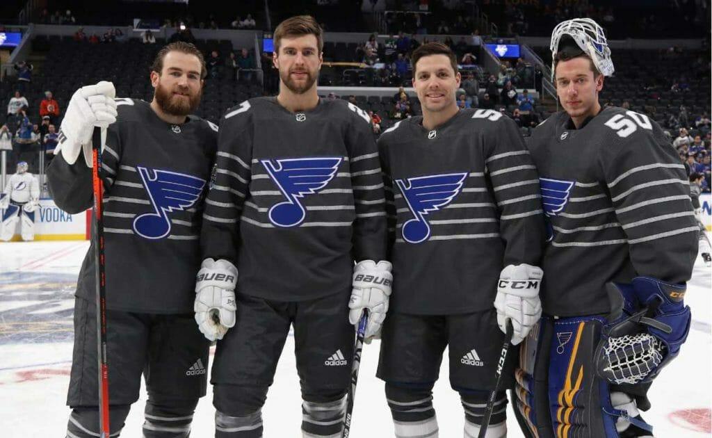 Ryan O'Reilly #90, Alex Pietrangelo #27, David Perron #57 and Jordan Binnington #50 of the St. Louis Blues pose for photos prior to the 2020 Honda NHL All-Star Game
