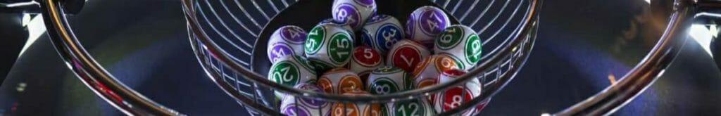 Colourful lottery balls in a lotto machine