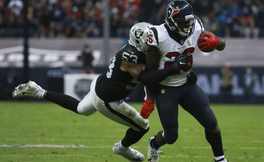 Houston Texans vs Oakland Raiders, player with ball tackled by opponent
