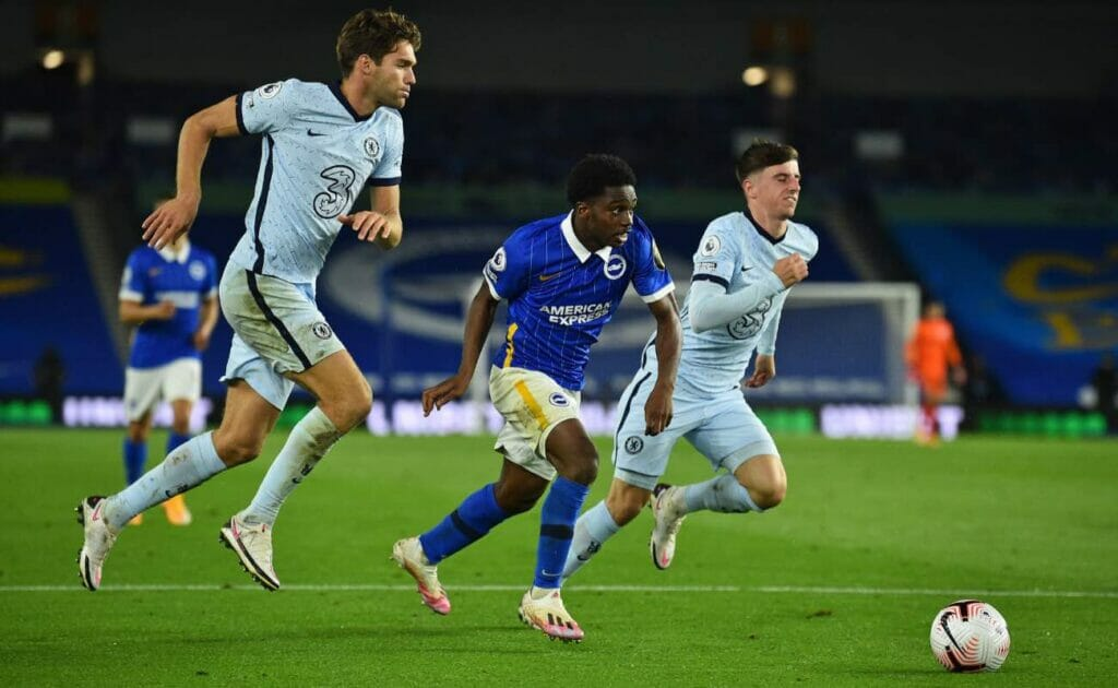 Tariq Lamptey beats Chelsea's defender Marcos Alonso and midfielder Mason Mount during the EPL football match in September 2020.