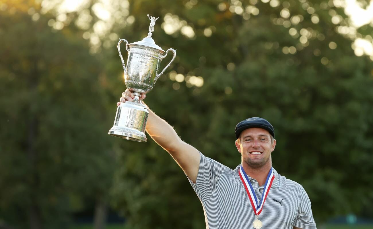 Bryson DeChambeau of the United States celebrates with the championship trophy after winning the 120th U.S. Open Championship on September 20, 2020