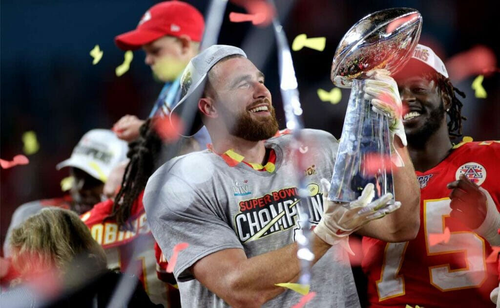 Travis Kelce of Kansas City Chiefs celebrates with the Vince Lombardi Trophy at Hard Rock Stadium February 2020