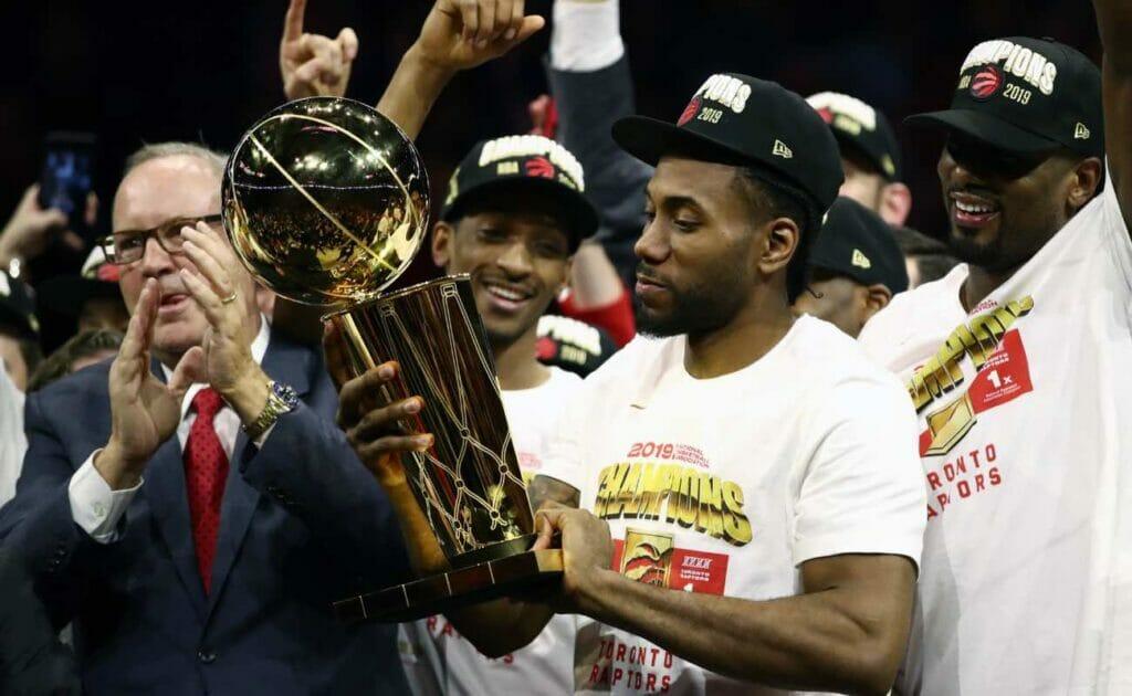 Kawhi Leonard of Toronto Raptors celebrates with the Larry O'Brien Championship Trophy at NBA Finals June 2019