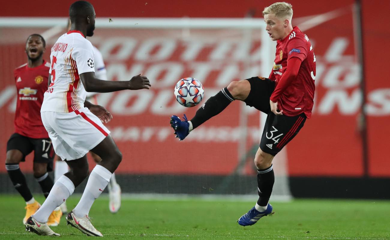 Donny Van De Beek of Manchester United challenged by Dayot Upamecano of RB Leipzig during the UEFA Champions League at Old Trafford October 2020. Photo by Clive Brunskill/Getty Images
