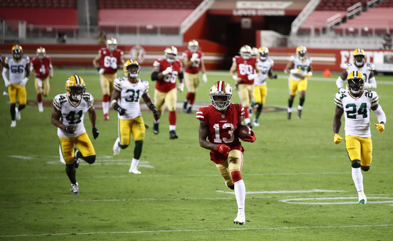 Richie James #13 of the San Francisco 49ers runs for a touchdown against the Green Bay Packers at Levi's Stadium November 2020. Photo by Ezra Shaw/Getty Images.