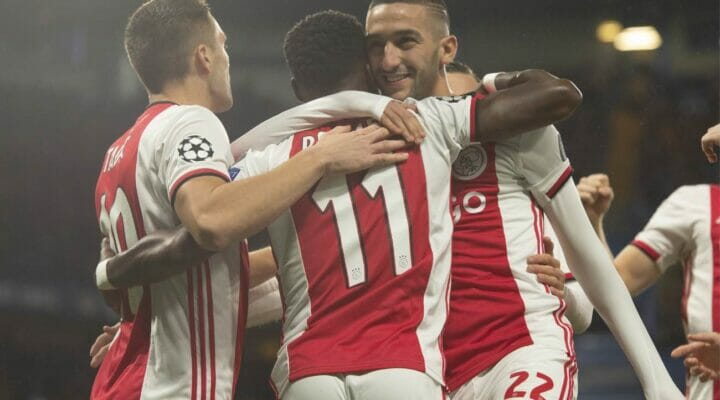 Quincy Promes of Ajax celebrates with Dusan Tadic and Hakim Ziyech the UEFA Champions at Stamford Bridge November 2019. Photo by Visionhaus - Getty Images.