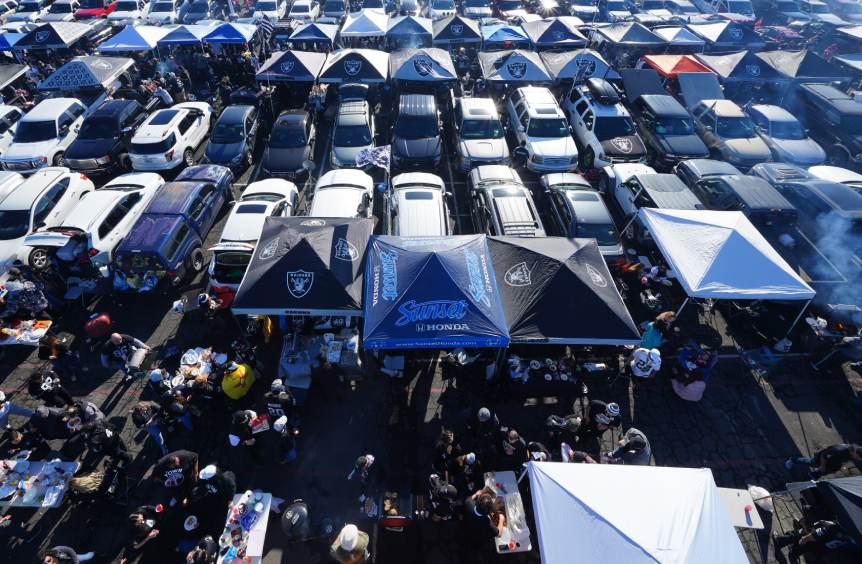 Oakland Raiders fans tailgate outside a stadium. Photo by Daniel Shirey/Getty Images.