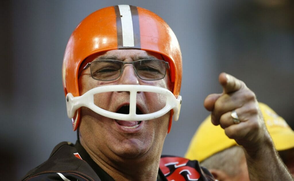 : A Cleveland Browns fan wears a helmet and points his finger towards the camera. Photo by Ralph Freso/Getty Images.