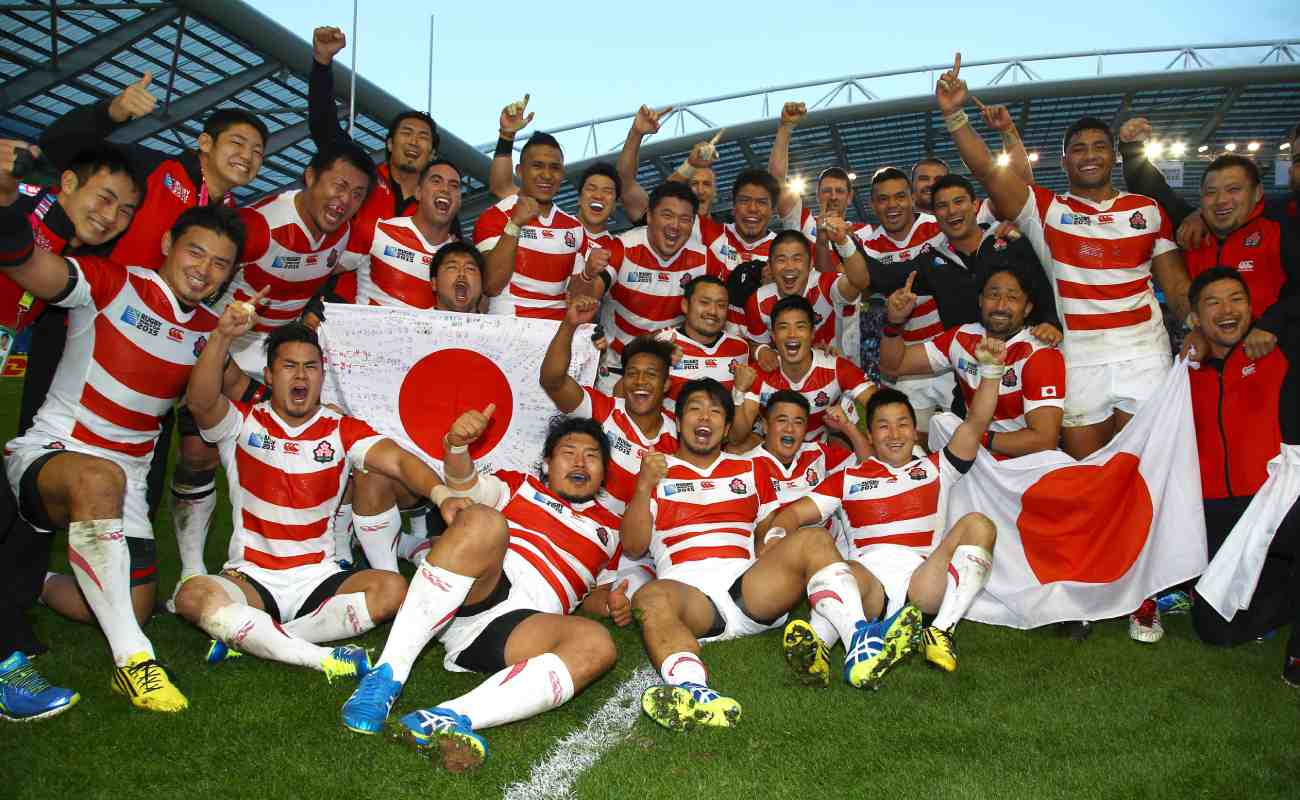 The Japanese rugby team celebrates after beating South Africa during the Rugby World Cup 2015. Photo by Steve Haag/Gallo Images/Getty Images