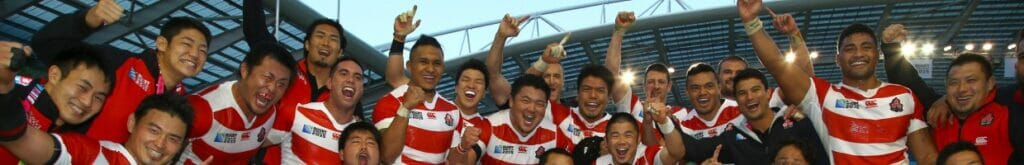 he Japanese rugby team celebrates after beating South Africa during the Rugby World Cup 2015. Photo by Steve Haag/Gallo Images/Getty Images