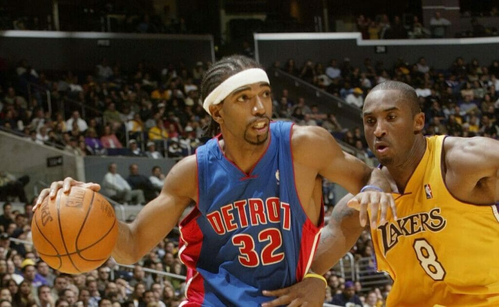 Richard Hamilton, playing for the Detroit Pistons, drives past Kobe Bryant during a Finals match in 2003. Photo by Stephen Dunn/Getty Images