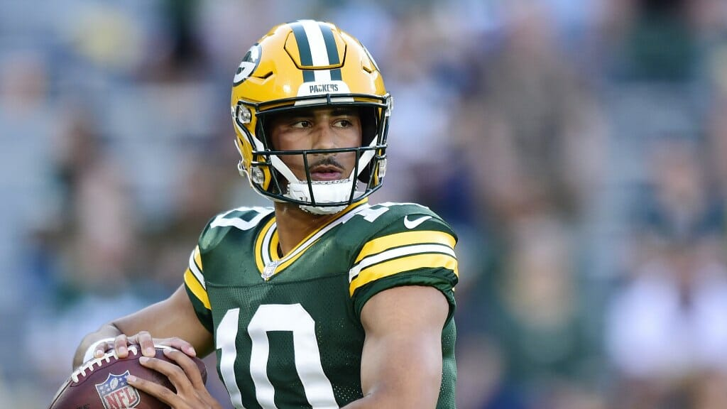 Jordan Love #10 of the Green Bay Packers throws a pass during warmups before the preseason game against the Houston Texans on August 14, 2021 (Photo by Patrick McDermott/Getty Images)
