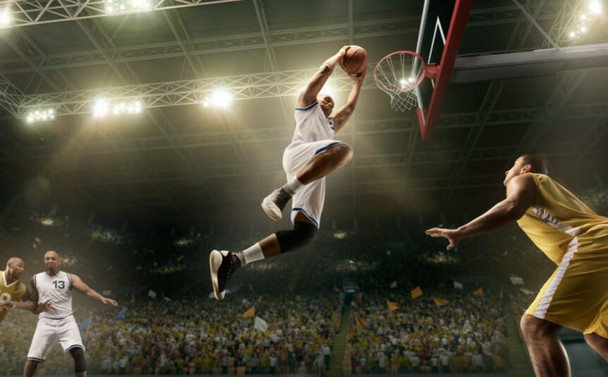 An NBA player goes for a slam dunk.
