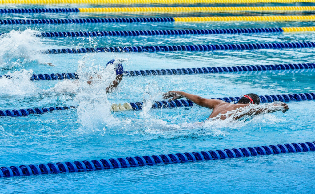 Male competitive swimmers competing in a butterfly race.