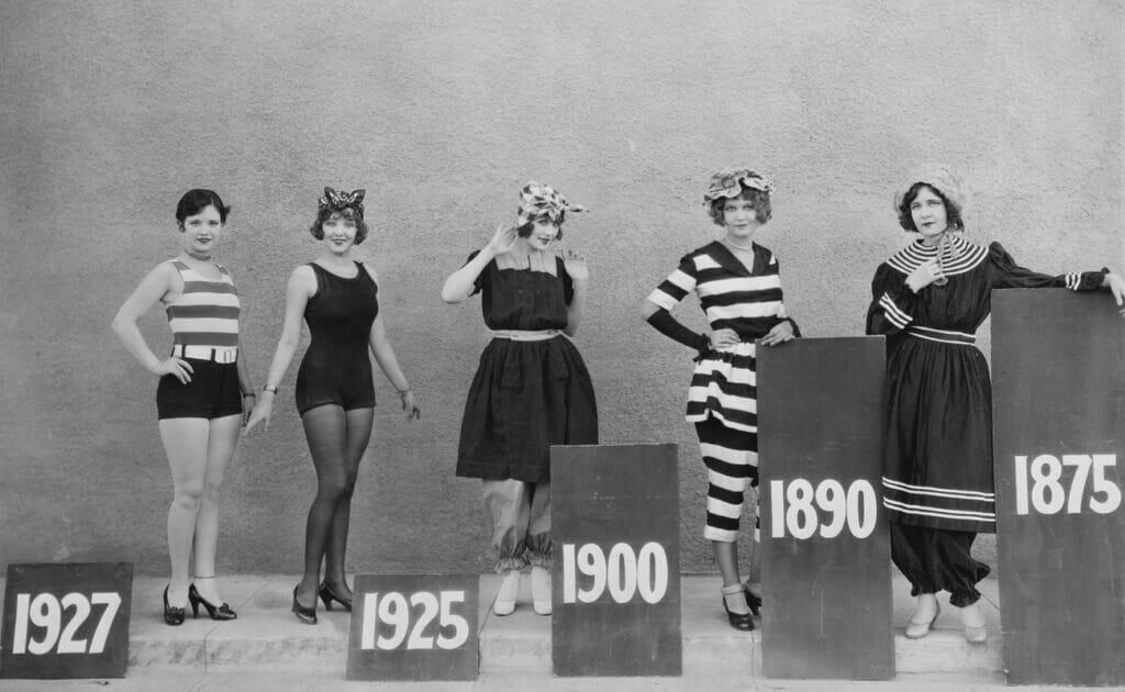 Women wearing the swimming fashions of various eras.