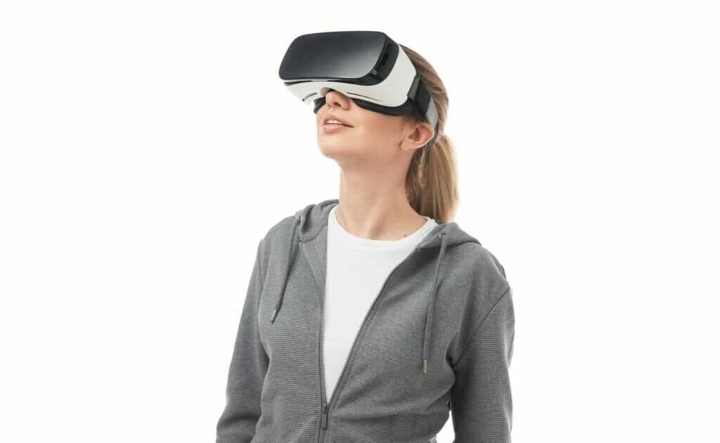 A woman wears a VR headset.