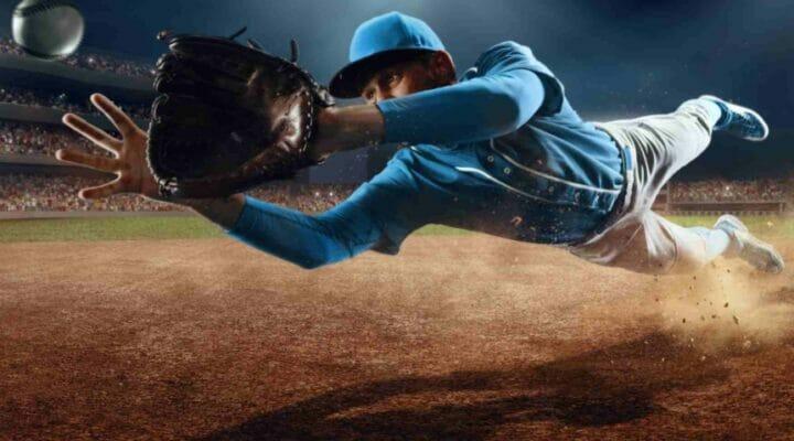 A shortstop leaps for a baseball.