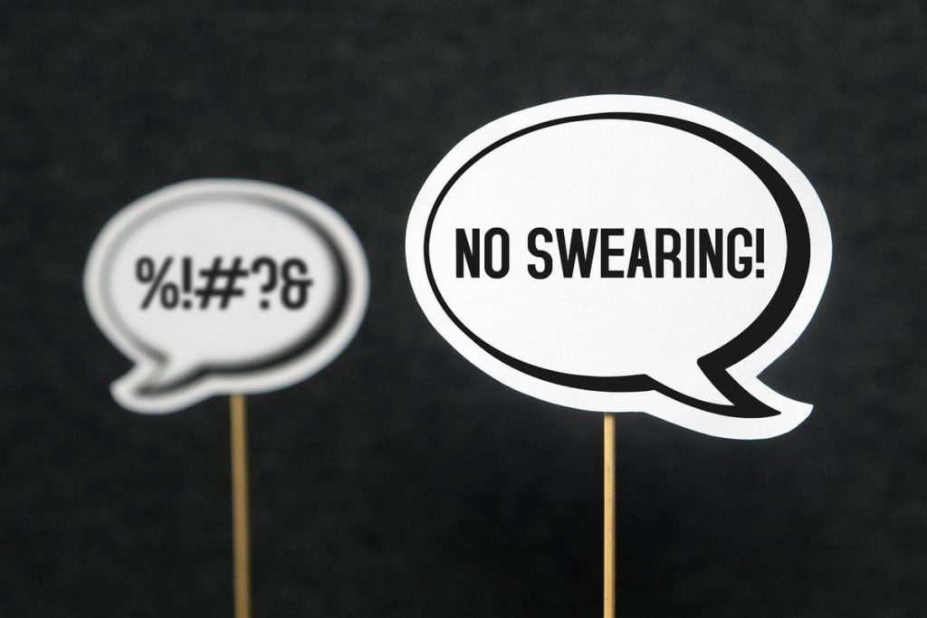2 black and white speech bubbles indicating swearing and no swearing