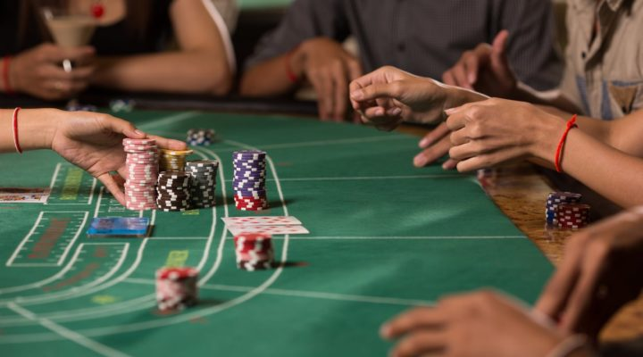 Player winning chip with betting baccarat with banker hand
