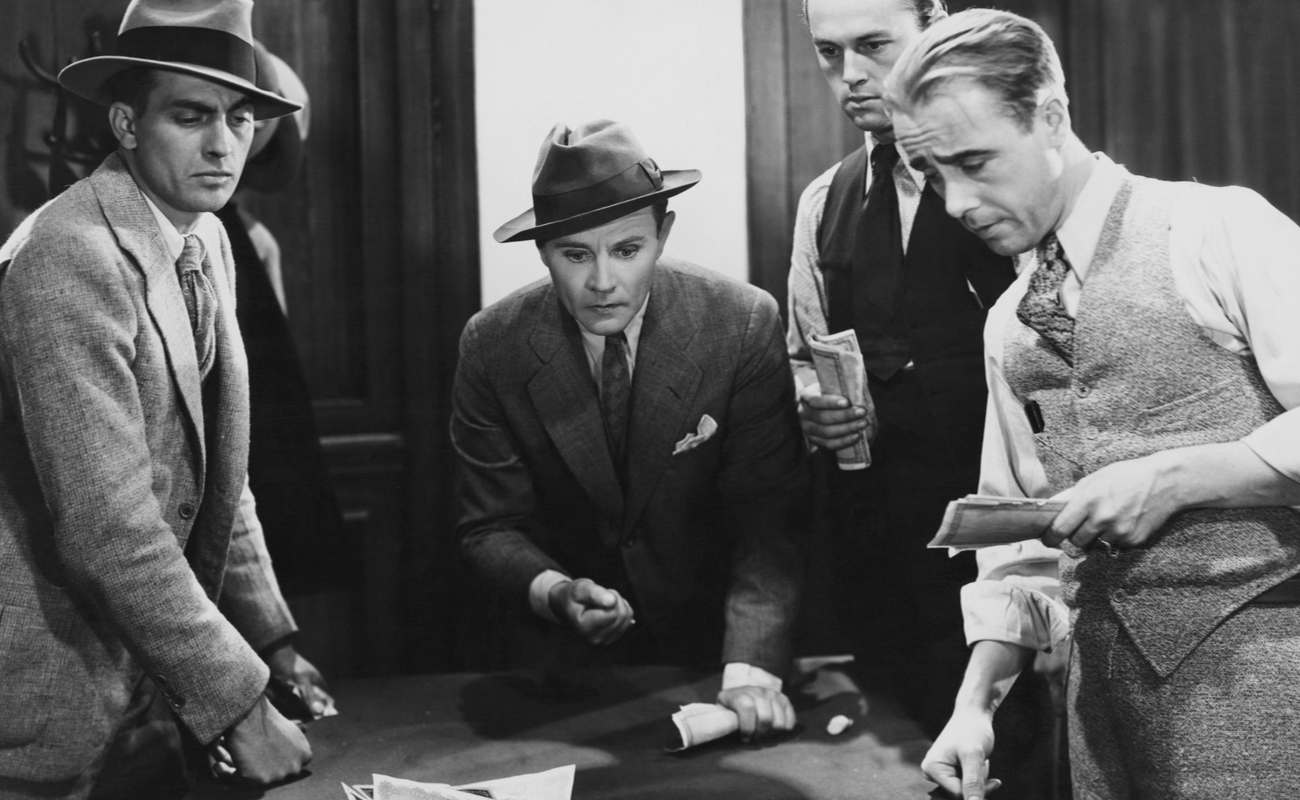 mafia type men gambling and looking concerned
