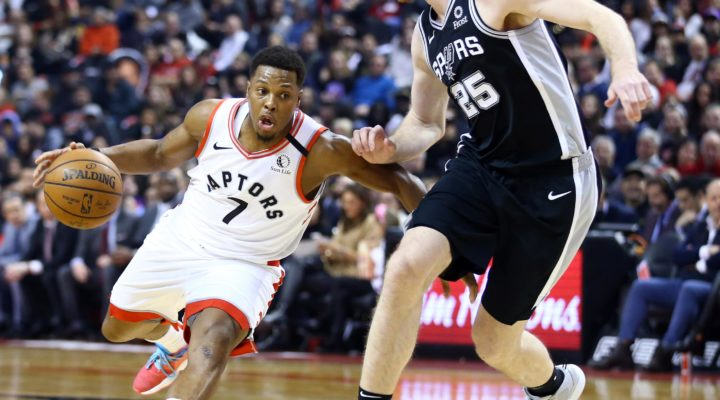 Kyle Lowry #7 of the Toronto Raptors dribbles the ball as Jakob Poeltl #25 of the San Antonio Spurs defends during the first half of an NBA game at Scotiabank Arena on January 12, 2020 in Toronto, Canada.