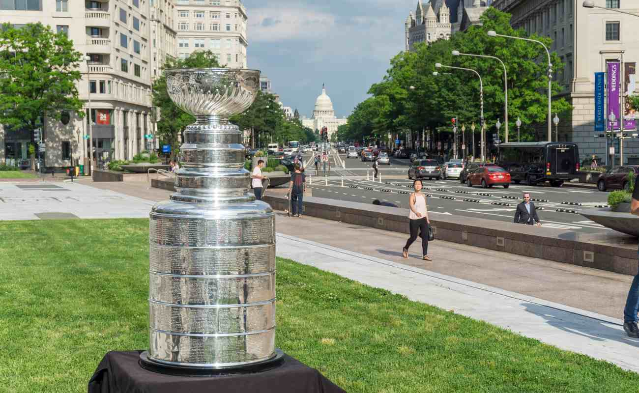 Stanley cup out for display on a black table placed on a grass surface