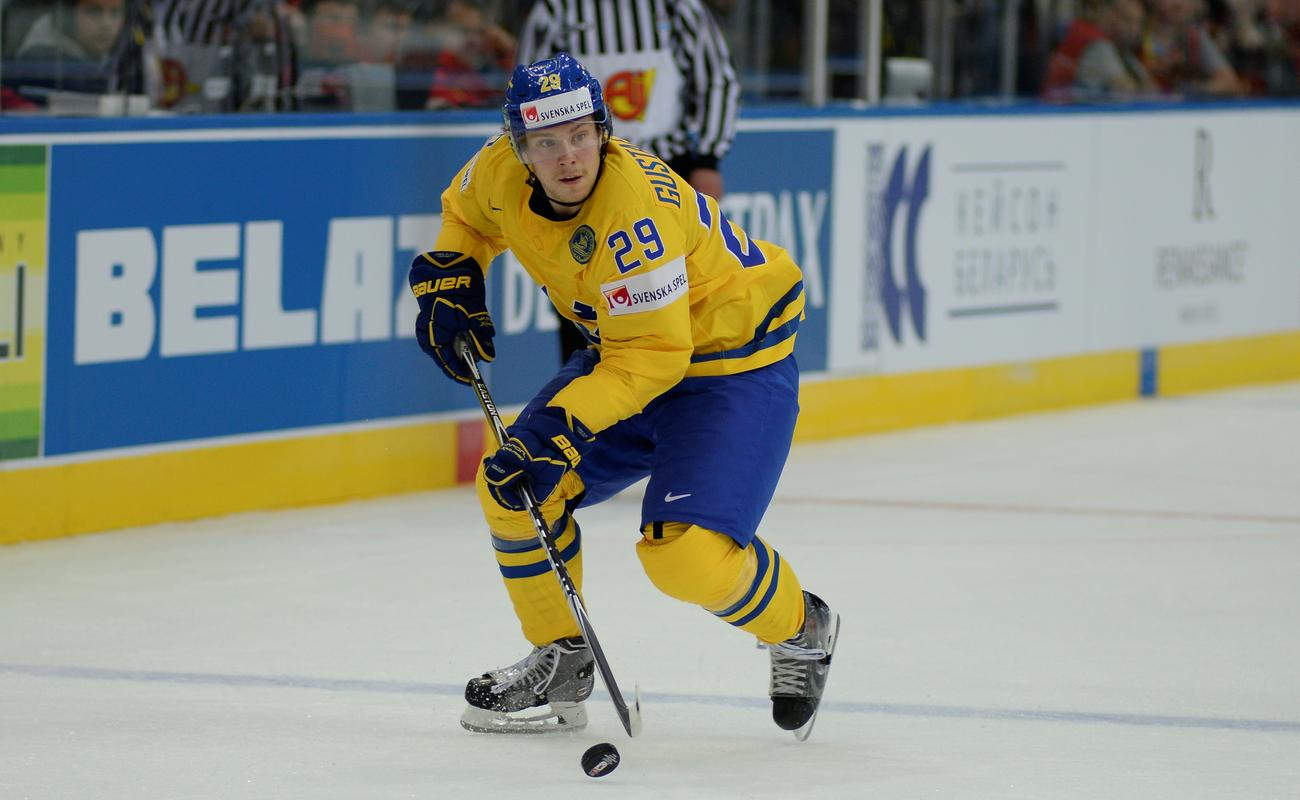 Erik Gustafsson dribbling the puck in a game