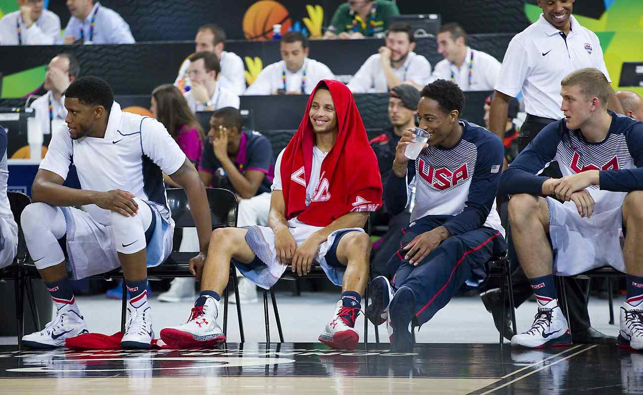 Stephen Curry resting and laughing with teammates