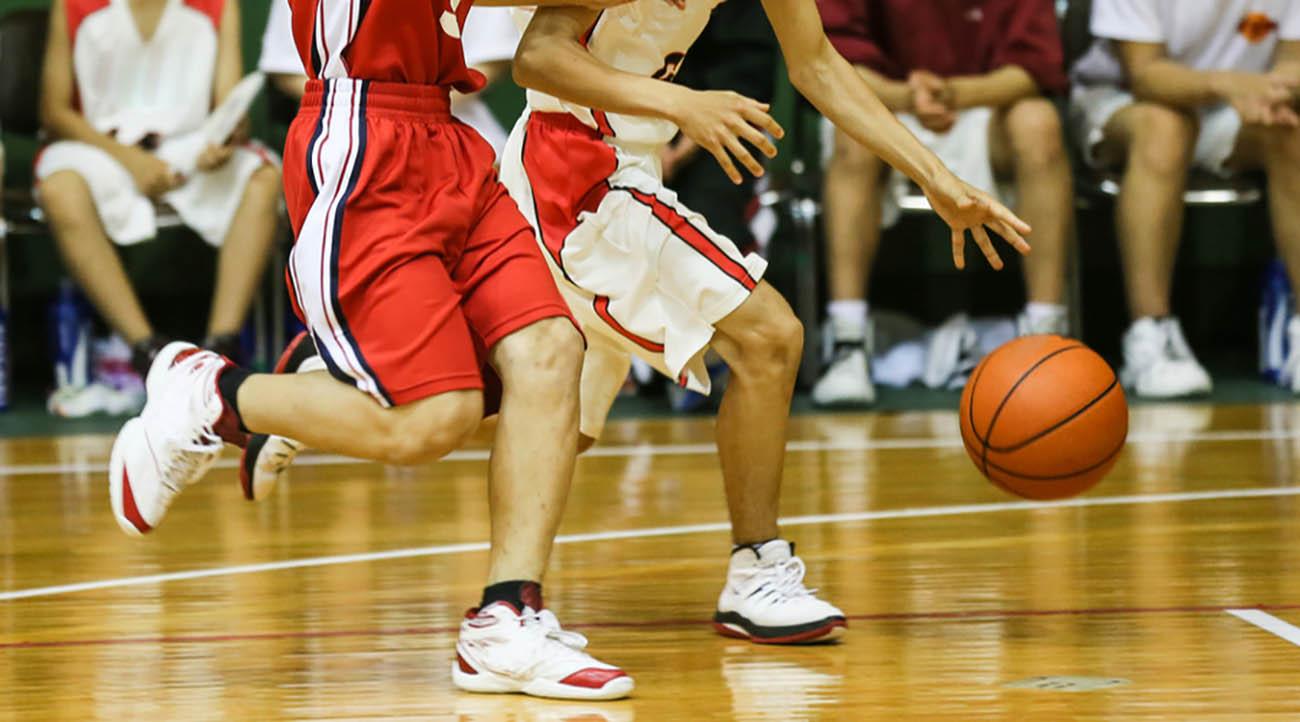 Basketball players feet chasing and basketball