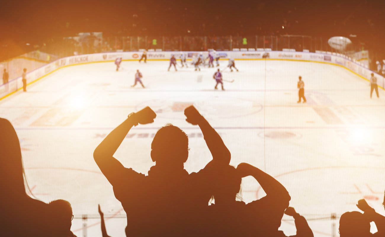 Hockey fans cheering in the shadow