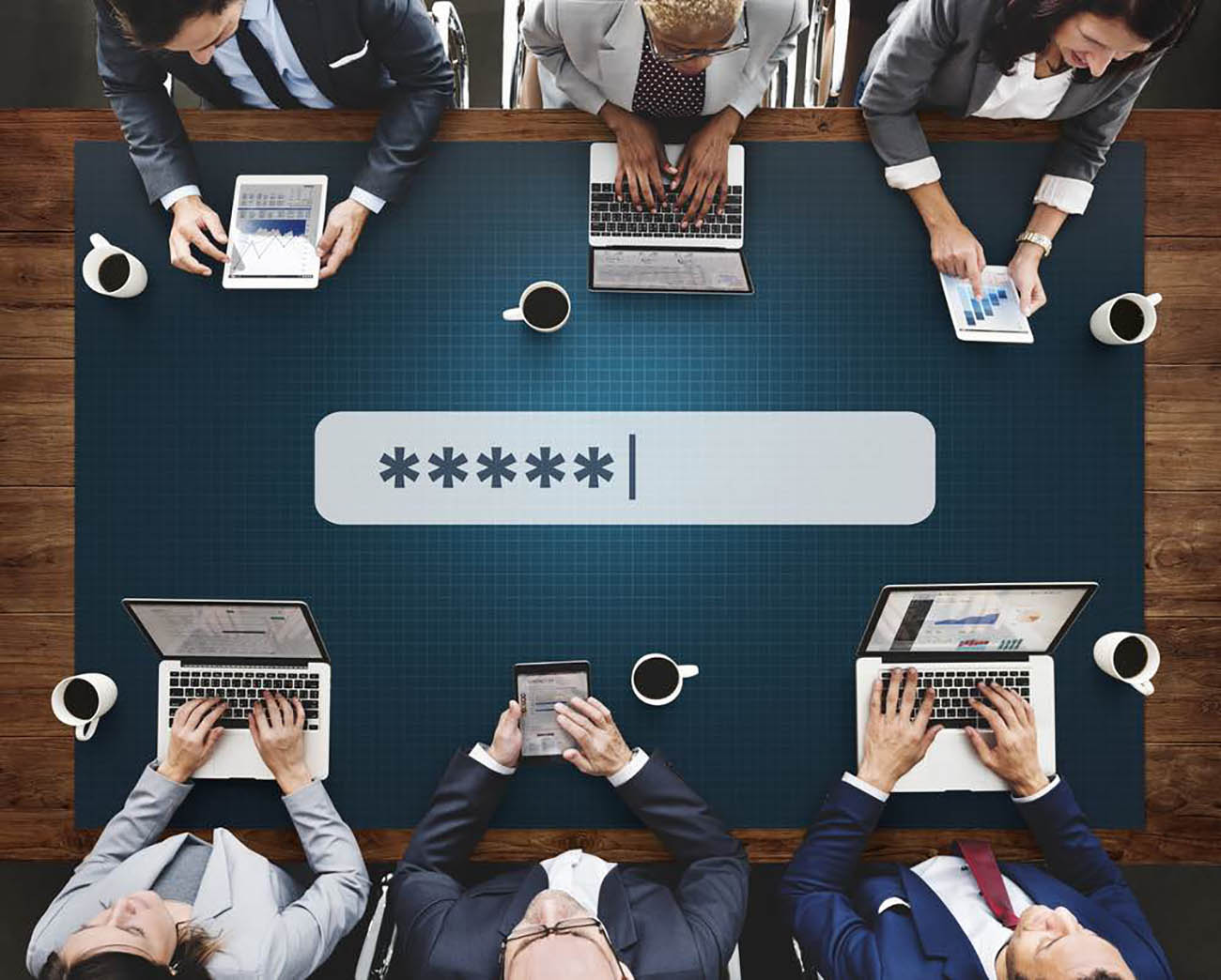executives_sitting_around_a_table_navigating_digital_devices
