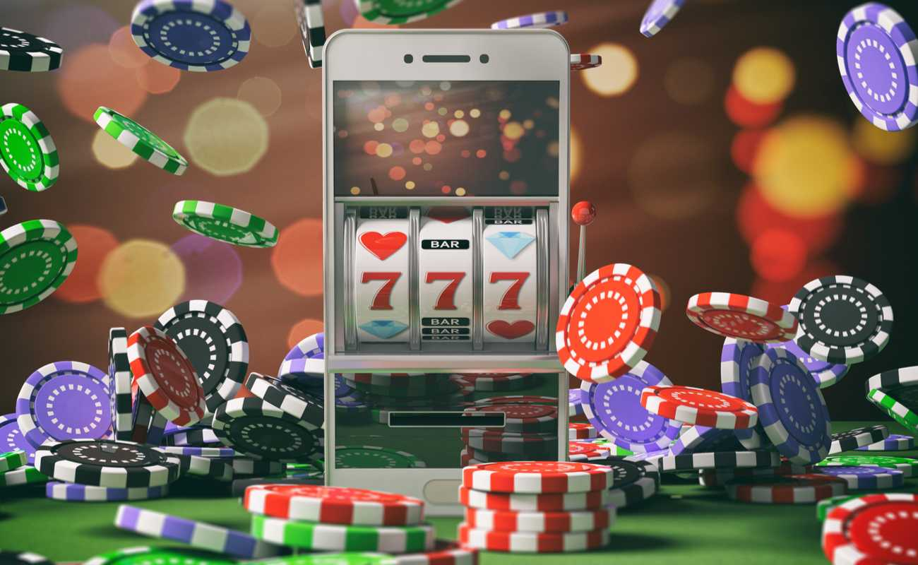 smartphone showing slots win with phone surrounded by casino chips
