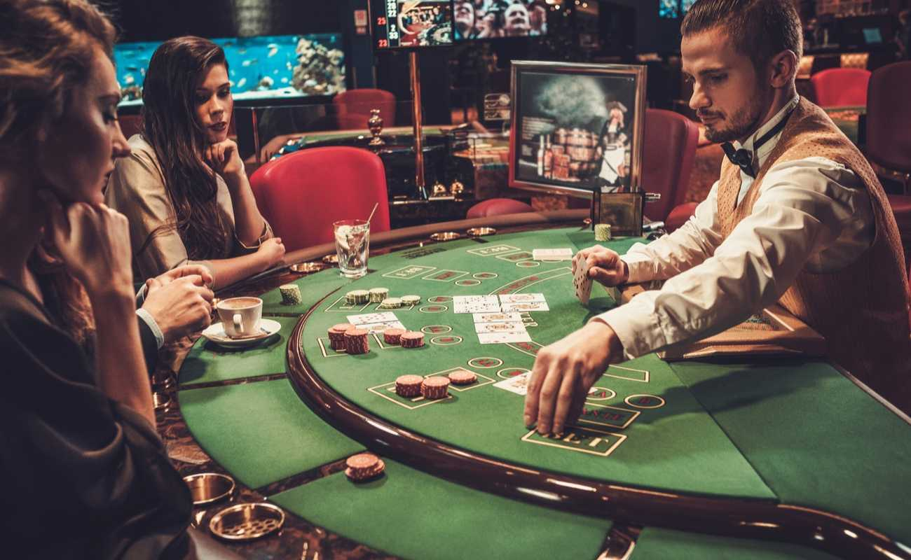 beautiful young women playing poker in a casino