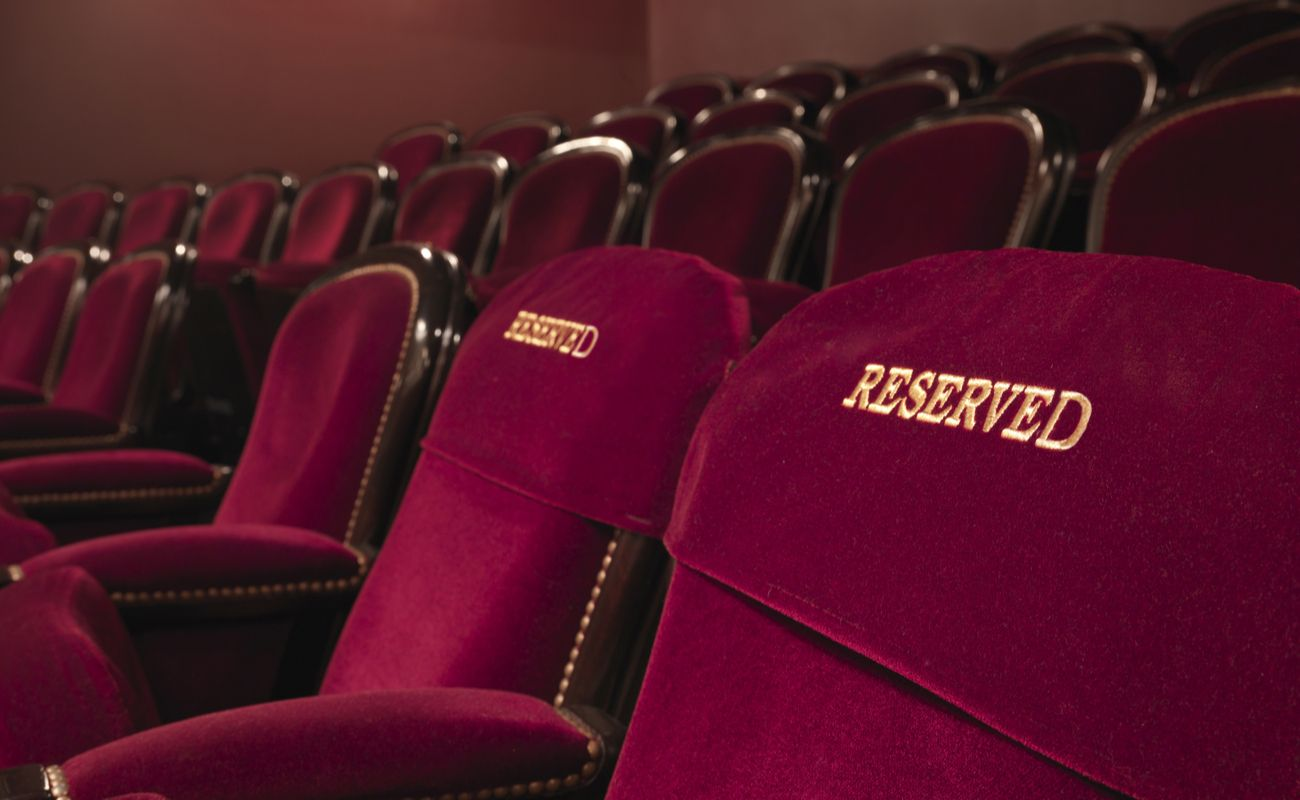 Red velvet front row seats with 2 seats embroidered with the word reserved