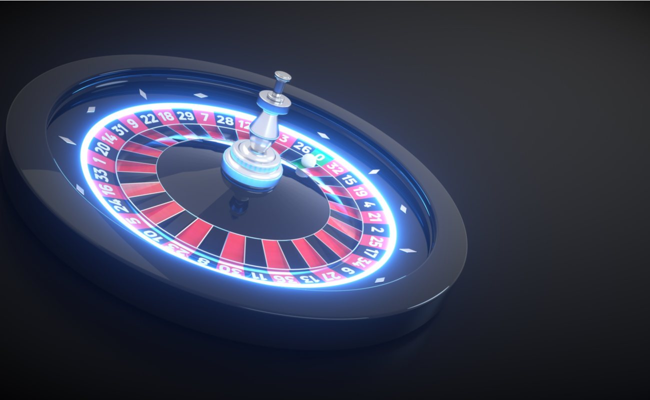 Light up roulette table, with blue lights and black background.