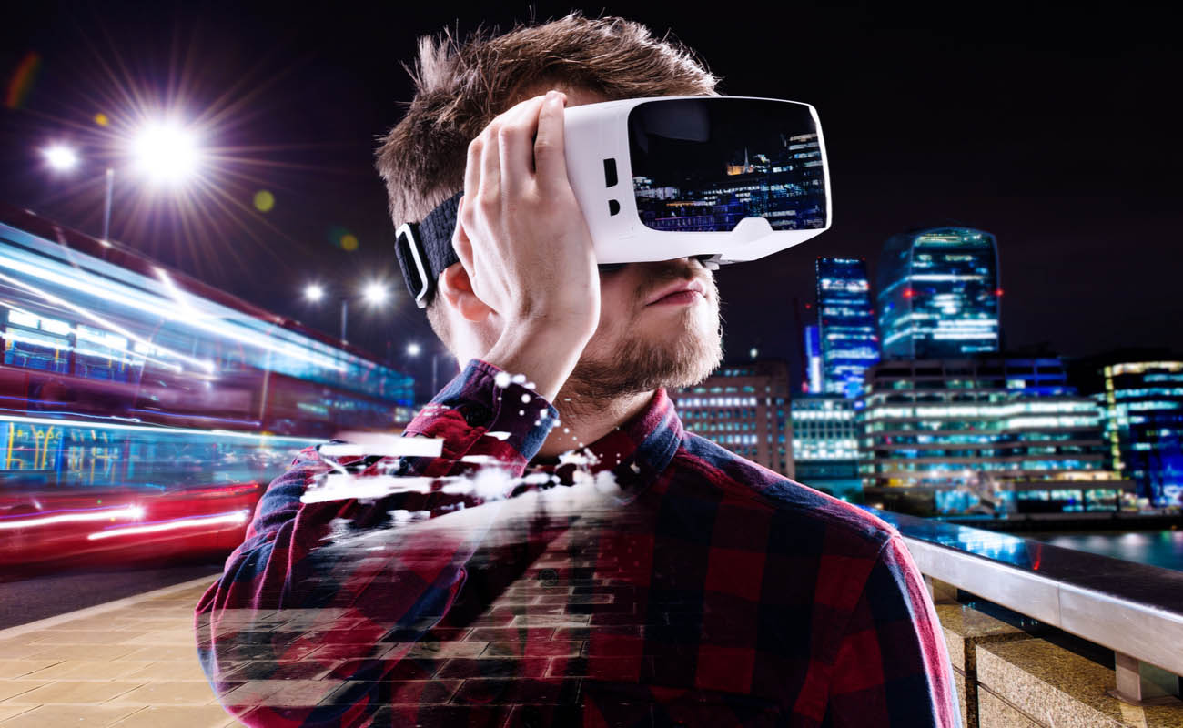 man wearing virtual reality headset with blurred city around him