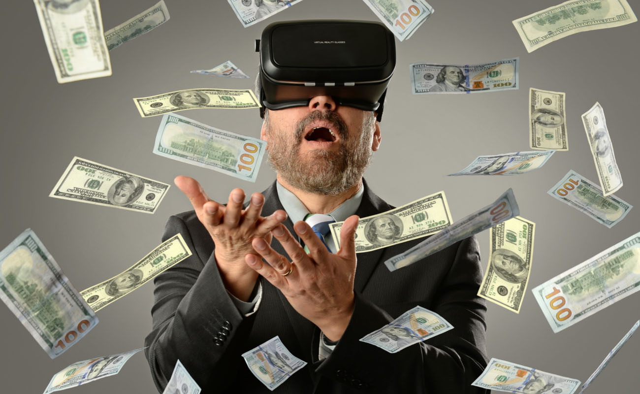 man in suit wearing virtual reality headset with money flying all around him
