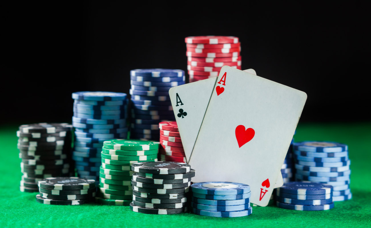pile of poker chips and two aces symbolizing poker