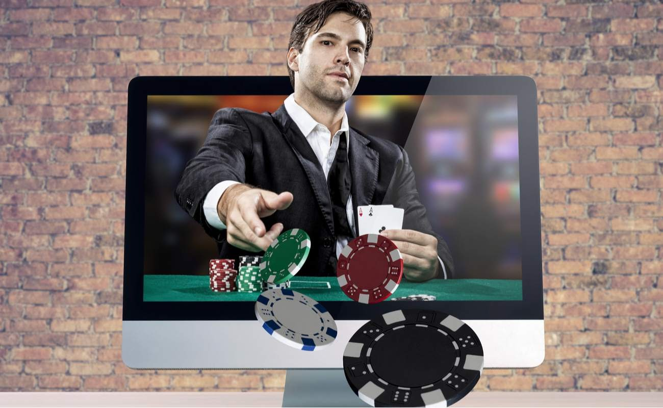 Online poker game, with the poker player coming out of the computer screen