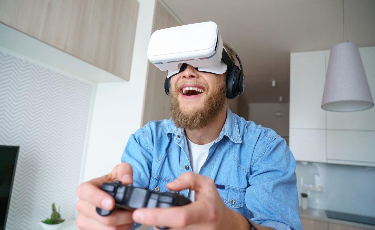 Gamer wearing vr glasses headset, holding gaming controller