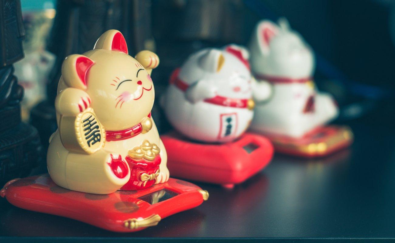 Three Maneki Neko Japanese lucky cat figures