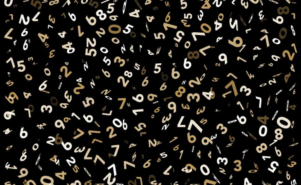 Random numbers in gold on black background