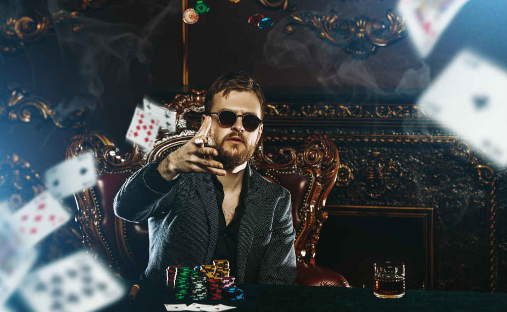 A wealthy mature man playing poker in a casino