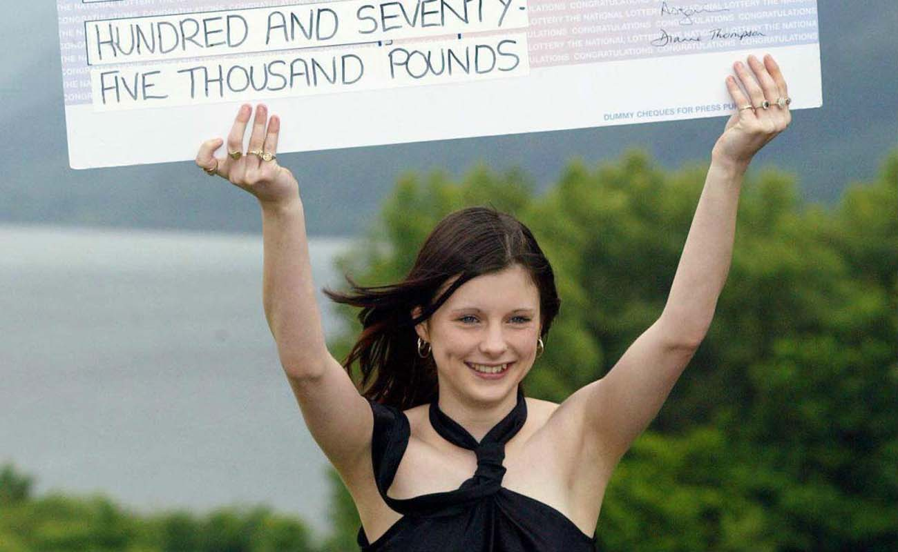 Callie Rogers holding a cheque