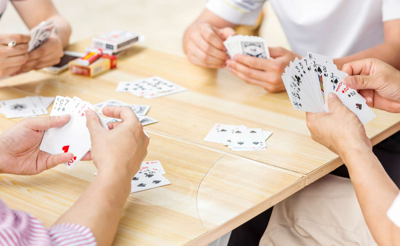 playing cards around the table