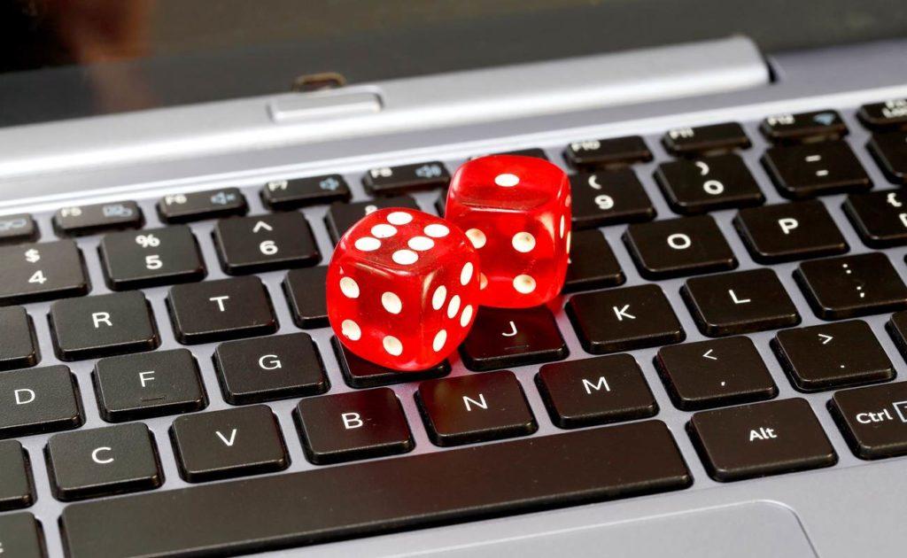 Red dice on laptop keyboard