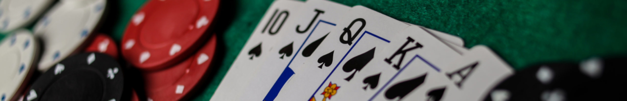 Poker royal flush next to community cards and chips on poker table.