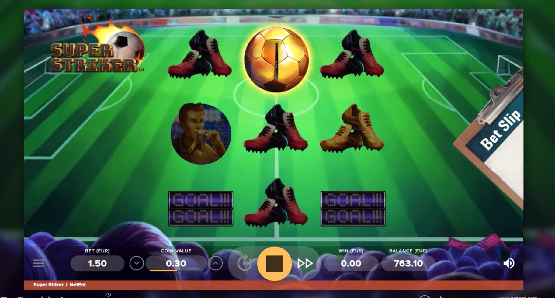 Super Striker slot screenshot with a soccer field in the background and a golden soccer ball.