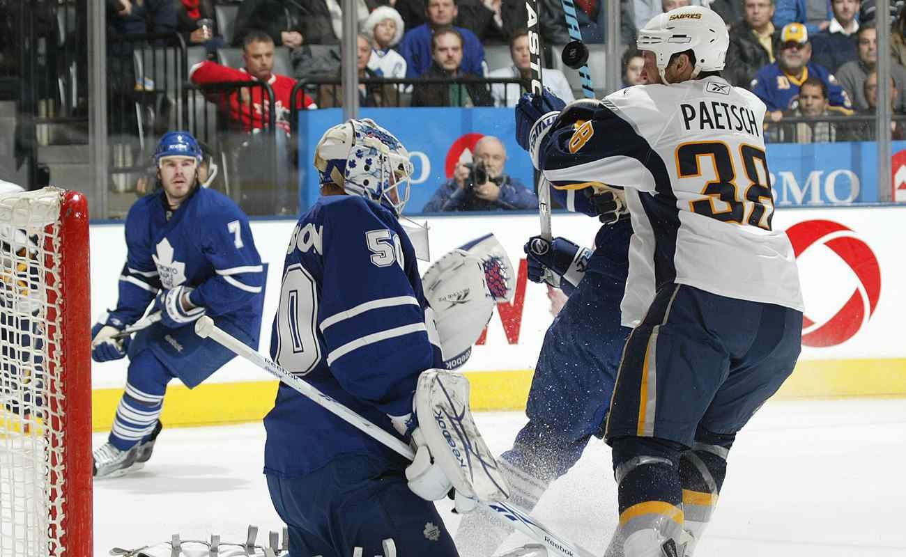 Boston Sabres vs Toronto Maple Leafs, players attempting to score a goal